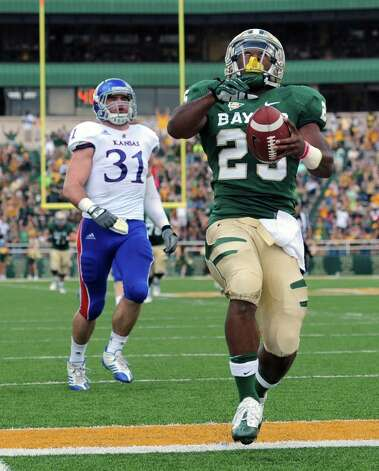 Baylor running back Lache Seastrunk, right,  scores on Kansas linebacker Ben Heeney (31), left, in the first half of an NCAA college football game on Nov. 3, 2012, in Waco. Photo: AP Photo/Waco Tribune Herald, Rod Aydelotte / Waco Tribune Herald