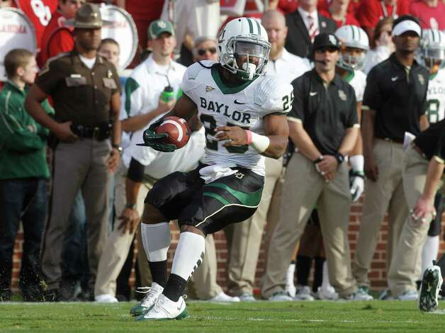 Baylor running back Lache Seastrunk (25) carries against Oklahoma during an NCAA college football game in Norman, Okla., Nov. 10, 2012. Photo: Sue Ogrocki, Associated Press / AP