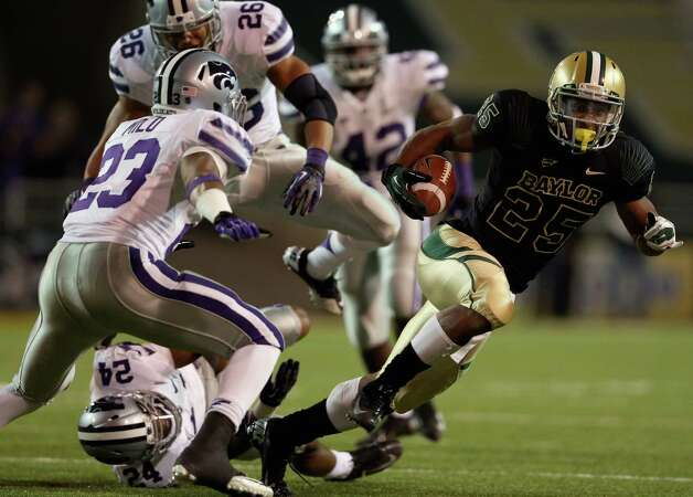 Lache Seastrunk #25 of the Baylor Bears runs the ball past Jarard Milo #23 of the Kansas State Wildcats at Floyd Casey Stadium on Nov. 17, 2012, in Waco. Photo: Ronald Martinez, Getty Images / 2012 Getty Images