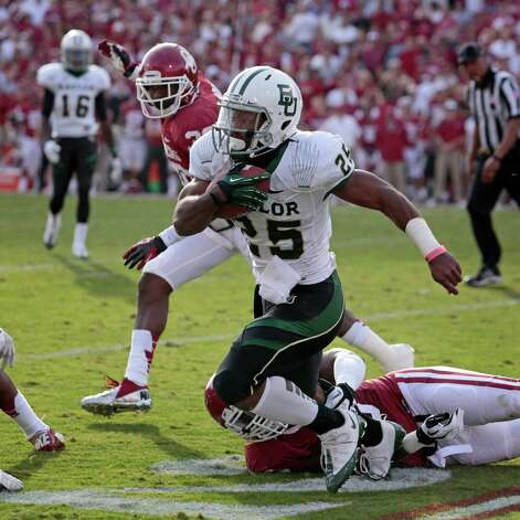 Running back Lache Seastrunk #25 of the Baylor Bears runs downfield against the Oklahoma Sooners Nov. 10, 2012, at Gaylord Family-Oklahoma Memorial Stadium in Norman, Okla. Oklahoma defeated Baylor 42-34. Photo: Brett Deering, Getty Images / 2012 Getty Images