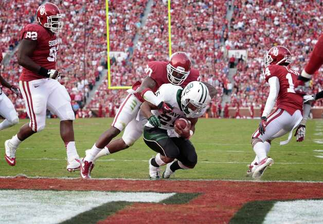 Defensive back Javon Harris #30 of the Oklahoma Sooners hits running back Lache Seastrunk #25 of the Baylor Bears too late Nov. 10, 2012, at Gaylord Family-Oklahoma Memorial Stadium in Norman, Okla. Oklahoma defeated Baylor 42-34. Photo: Brett Deering, Getty Images / 2012 Getty Images
