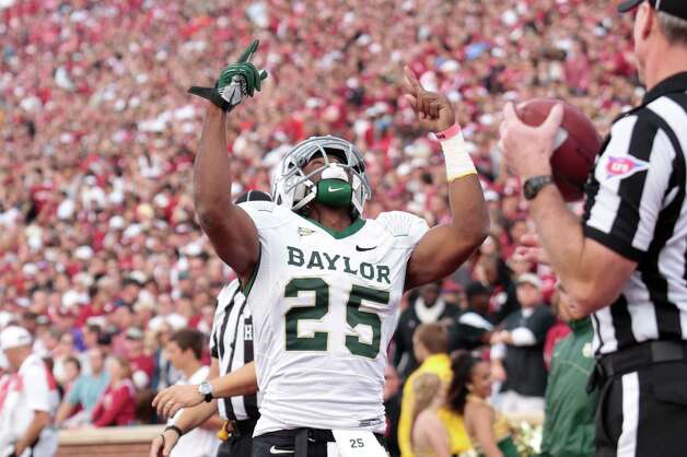 Running back Lache Seastrunk #25 of the Baylor Bears celebrates a touchdown against the Oklahoma Sooners Nov. 10, 2012, at Gaylord Family-Oklahoma Memorial Stadium in Norman, Okla. Photo: Brett Deering, Getty Images / 2012 Getty Images