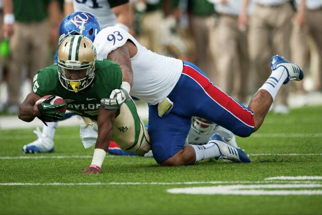 Lache Seastrunk #25 of the Baylor University Bears dives for extra yardage against the University of Kansas Jayhawks on Nov. 3, 2012, at Floyd Casey Stadium in Waco. Photo: Cooper Neill, Getty Images / 2012 Getty Images