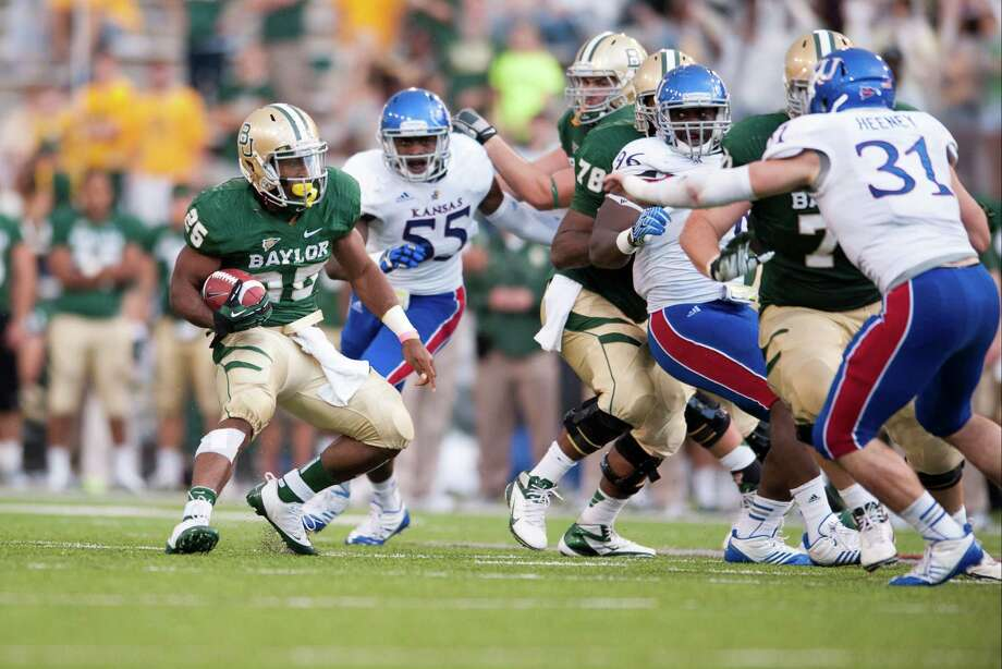 Lache Seastrunk #25 of the Baylor University Bears breaks free against the University of Kansas Jayhawks on Nov. 3, 2012, at Floyd Casey Stadium in Waco. Photo: Cooper Neill, Getty Images / 2012 Getty Images
