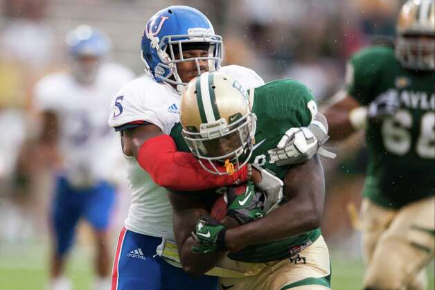 Glasco Martin #8 of the Baylor University Bears is tackled by Greg Brown #5 of the University of Kansas Jayhawks on Nov. 3, 2012, at Floyd Casey Stadium in Waco. Photo: Cooper Neill, Getty Images / 2012 Getty Images