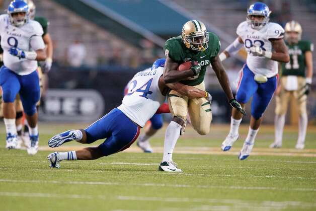 Glasco Martin #8 of the Baylor University Bears is tackled by Bradley McDougald #24 of the University of Kansas Jayhawks on Nov. 3, 2012 at Floyd Casey Stadium in Waco. Photo: Cooper Neill, Getty Images / 2012 Getty Images
