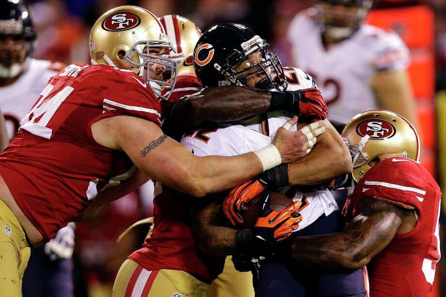 Chicago Bears running back Matt Forte (22) is tackled by San Francisco 49ers defensive tackle Justin Smith, linebacker Patrick Willis, rear, and linebacker NaVorro Bowman during the third quarter of an NFL football game in San Francisco, Monday, Nov. 19, 2012. Photo: Marcio Jose Sanchez, Associated Press / AP