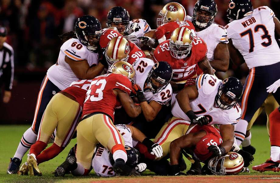 Chicago Bears running back Matt Forte (22) is tackled by San Francisco 49ers linebacker NaVorro Bowman (53) and other defenders during the first half of an NFL football game in San Francisco, Monday, Nov. 19, 2012. Photo: Marcio Jose Sanchez, Associated Press / AP