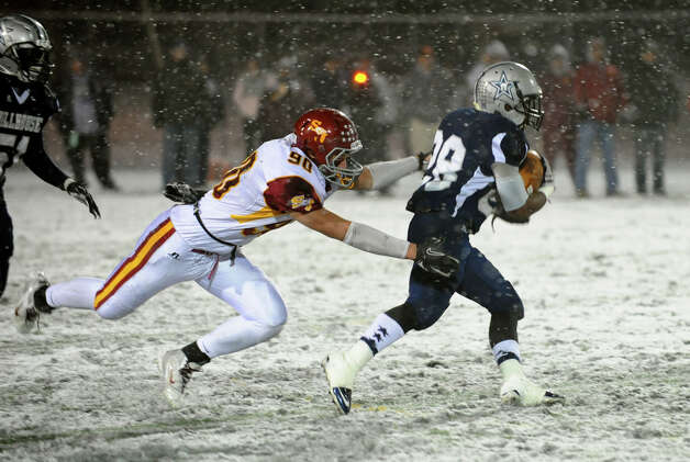 St. Joseph's #90 Ryan Moran lunges for Hillhouse's #28 Andre Anderson, during Class M state football quarterfinal action in East Haven, Conn. on Tuesday November 27, 2012. Photo: Christian Abraham / Connecticut Post