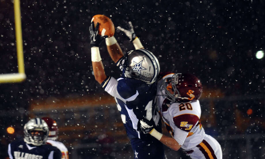 Hillhouse's #12 Daryn Horner completes a pass as St. Joseph's #20 Ryan Mulligan tries to block, during Class M state football quarterfinal action in East Haven, Conn. on Tuesday November 27, 2012. Photo: Christian Abraham / Connecticut Post