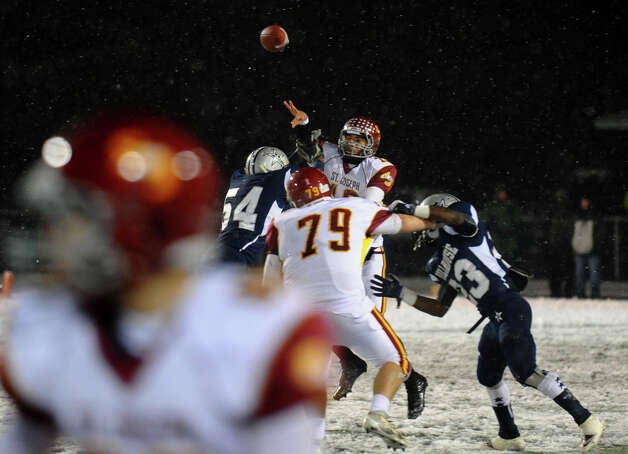 St. Joseph QB Jordan Vazzano releases a pass, during Class M state football quarterfinal action against Hillhouse in East Haven, Conn. on Tuesday November 27, 2012. Photo: Christian Abraham / Connecticut Post