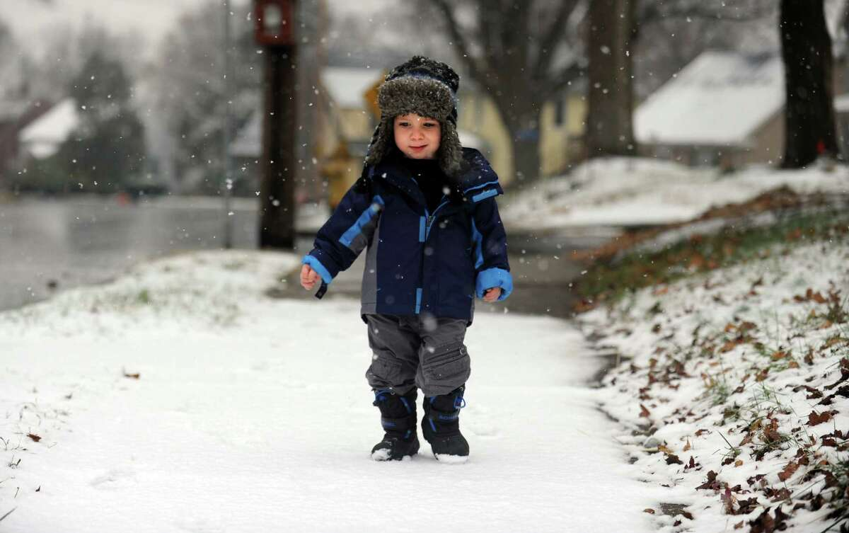 Two-year-old Jack Driscoll walks down Hawthorne Avenue on a snowy morning in Derby, Conn. Tuesday, Nov. 27, 2012.