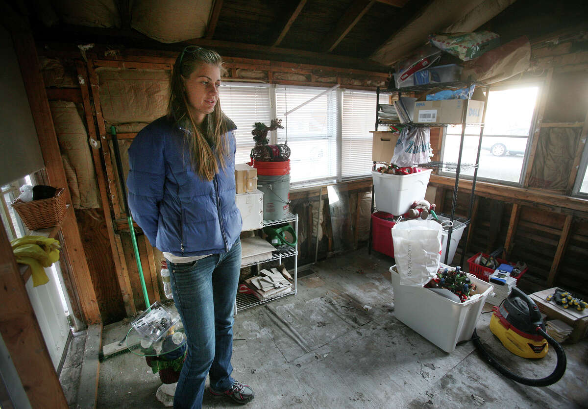 Bibi Schmit visits the now unoccupied home that she shares with her sister on Milford Point Road in Milford on Monday, November 26, 2012. Schmit said that the home, flooded during Hurricane Sandy, needs to be completely gutted on the ground floor.