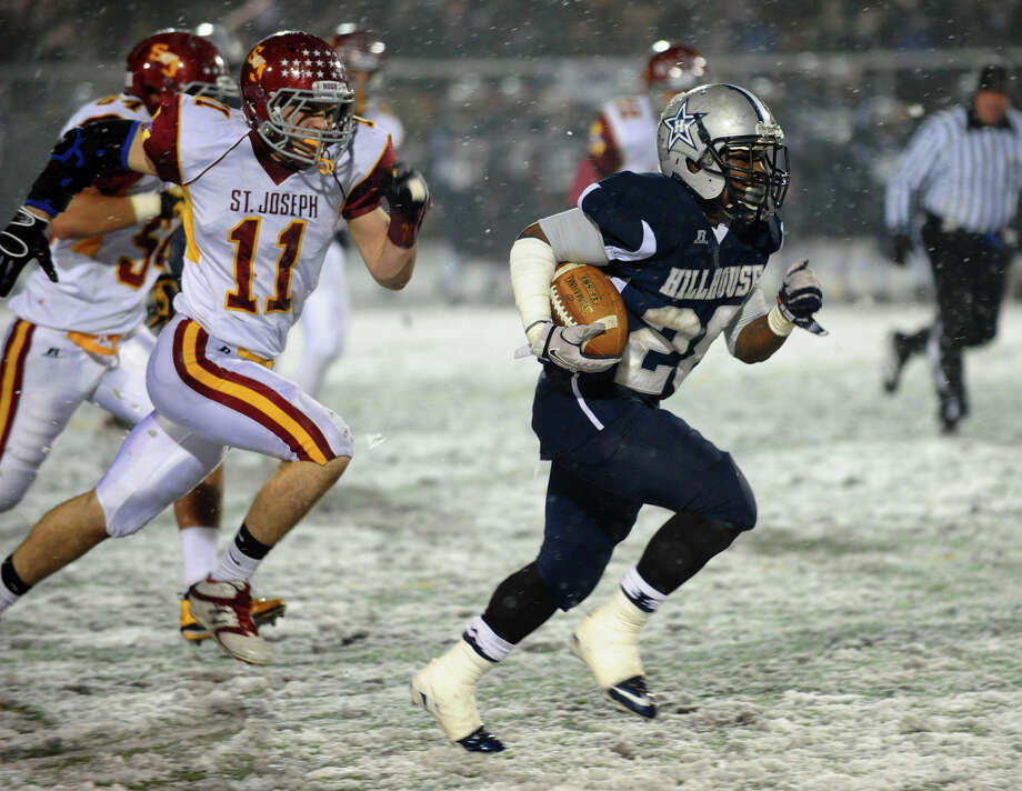 Hillhouse's #28 Andre Anderson breaks away for a touchdown run, during Class M state football quarterfinal action against St. Jospeh in East Haven, Conn. on Tuesday November 27, 2012. Photo: Christian Abraham / Connecticut Post