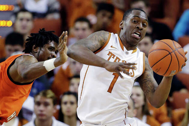 Texas' Sheldon McClellan (1) moves the ball past Sam Houston State's Darius Gatson, left, during the first half of an NCAA college basketball game, Tuesday, Nov. 27, 2012, in Austin, Texas. (AP Photo/Eric Gay) Photo: Eric Gay, Associated Press / AP