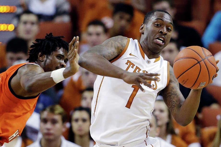 Texas' Sheldon McClellan (1) moves the ball past Sam Houston State's Darius Gatson, left, during the first half of an NCAA college basketball game, Tuesday, Nov. 27, 2012, in Austin, Texas. (AP Photo/Eric Gay) Photo: Eric Gay, Associated Press / AP
