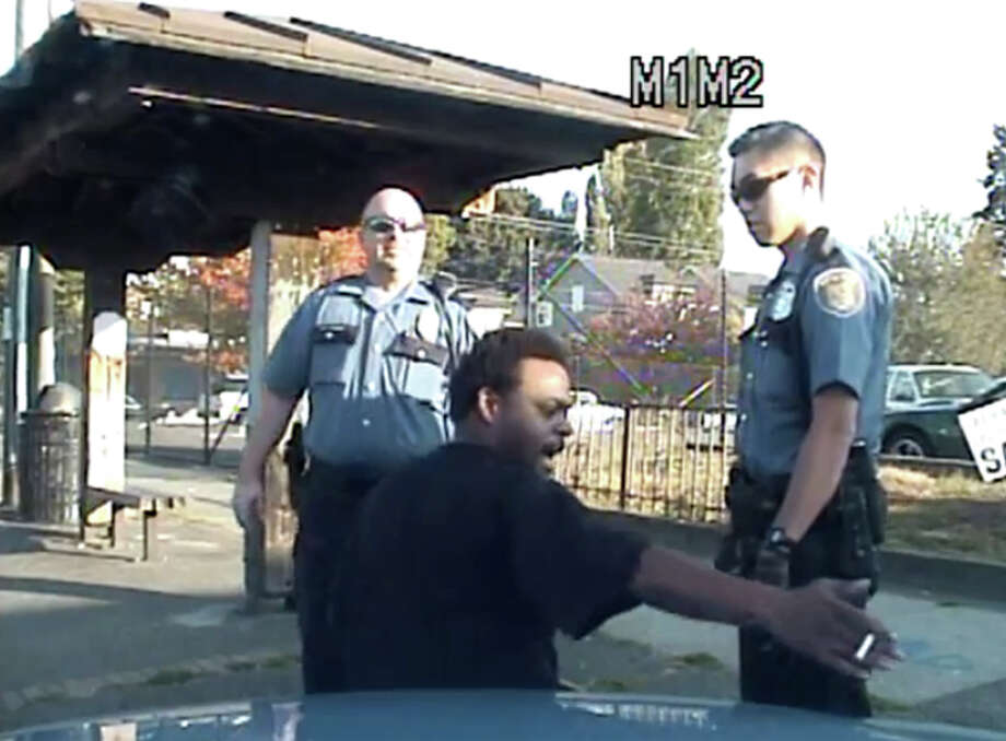A still frame from the dash-camera video of an Oct. 6 Seattle police incident involving Leo Etherly, who is suspected in a hit-and-run case. Police have the Office of Professional Accountability reviewing the officer's use of force, though investigators say Etherly was resisting arrest and was punched because he spit at officers. His attorney, who released the video, said Etherly did not intentionally spit at any officer and that his throat was swelling. He also said the officer did not de-escalate the situation properly nor did police release the video in a timely manner. Police say they complied with the public disclosure request and expedited it Nov. 27 because of increased public interest. Photo: YouTube