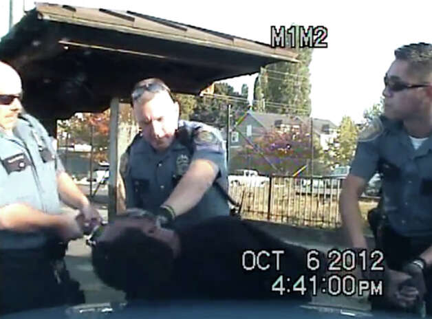 A still frame from the dash-camera video of an Oct. 6 Seattle police  incident involving Leo Etherly, who is suspected in a hit-and-run case. Photo: YouTube