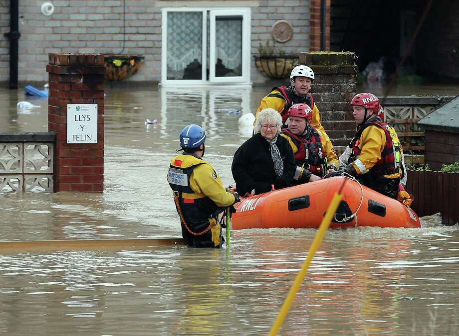 An RNLI life boat rescues residents in the flooded streets of St Asaph in North Wales after torrential overnight rain on November 27, 2012 in St Asaph, England. Residents in up to 500 homes in St Asaph have been advised to evacuate as flood waters continue to rise and the River Elwy breaks its banks. Photo: Christopher Furlong, Getty Images / 2012 Getty Images