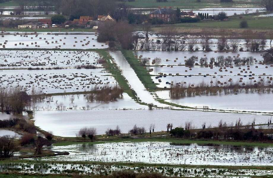 Flood water can be seen in fields surrounding the Glastonbury Tor on the Somerset Levels, on November 25, 2012 near Glastonbury, England. Another band of heavy rain and wind continued to bring disruption to many parts of the country today particularly in the south west which was already suffering from flooding earlier in the week. Photo: Matt Cardy, Getty Images / 2012 Getty Images