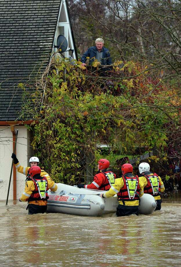 Rescue crews prepare to evacuate residents from flood waters in St Asaph, north Wales on November 27, 2012. Hundreds of people were urged to flee their homes in north Wales on Tuesday after a river surged over flood defences, as torrential rain fell across Britain for a seventh day. Photo: PAUL ELLIS, AFP/Getty Images / AFP