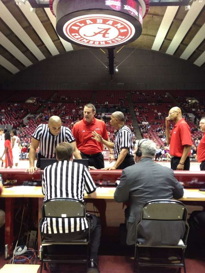 Lamar men's basketball coach Pat Knight talks with officials after he was ejected from a game Tuesday, Nov. 27, at Alabama. Knight received two technical fouls in a short period of time. Photo from Twitter.com/bwaters3