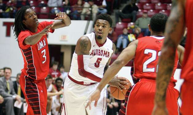 Alabama guard Trevor Lacey (5) looks to move the ball past Lamar guards Donnell Minton (3) and Lamar Donley Minor (22) during an NCAA college basketball game in Tuscaloosa, Ala. Tuesday, Nov. 27, 2012. (AP Photo/Tuscaloosa News, Michelle Lepianka Carter) Photo: Michelle Lepianka Carter, MBO / Tuscaloosa News