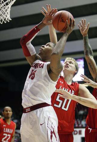 Alabama forward Nick Jacobs (15) takes the ball to the basket as Lamar forward Sebastian Norman (50) defends during an NCAA college basketball game in Tuscaloosa, Ala. Tuesday, Nov. 27, 2012. (AP Photo/Tuscaloosa News, Michelle Lepianka Carter) Photo: Michelle Lepianka Carter, MBO / Tuscaloosa News