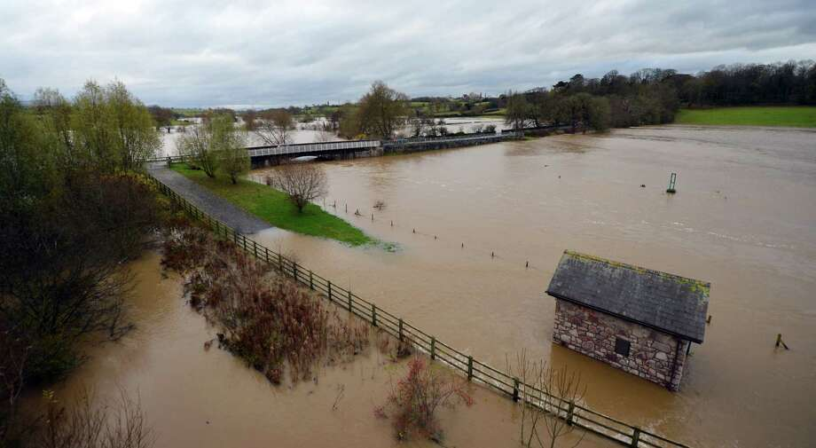 The flooded River Clywd is pictured near St Asaph in north Wales, on November 27, 2012. More than 800 homes in England and Wales have been flooded as heavy rain and strong winds battered the country and environmental officials warned of more downpours to come. Photo: PAUL ELLIS, AFP/Getty Images / AFP