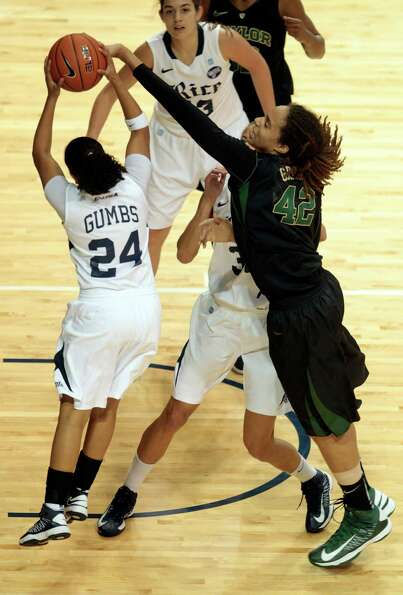 Rice's Elena Gumbs has her shot blocked by Baylor center Brittney Griner during the first half.