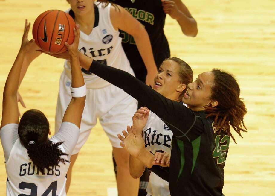 Rice's Elena Gumbs has her shot blocked by Baylor center Brittney Griner during the first half. Photo: Billy Smith II, Houston Chronicle / © 2012 Houston Chronicle