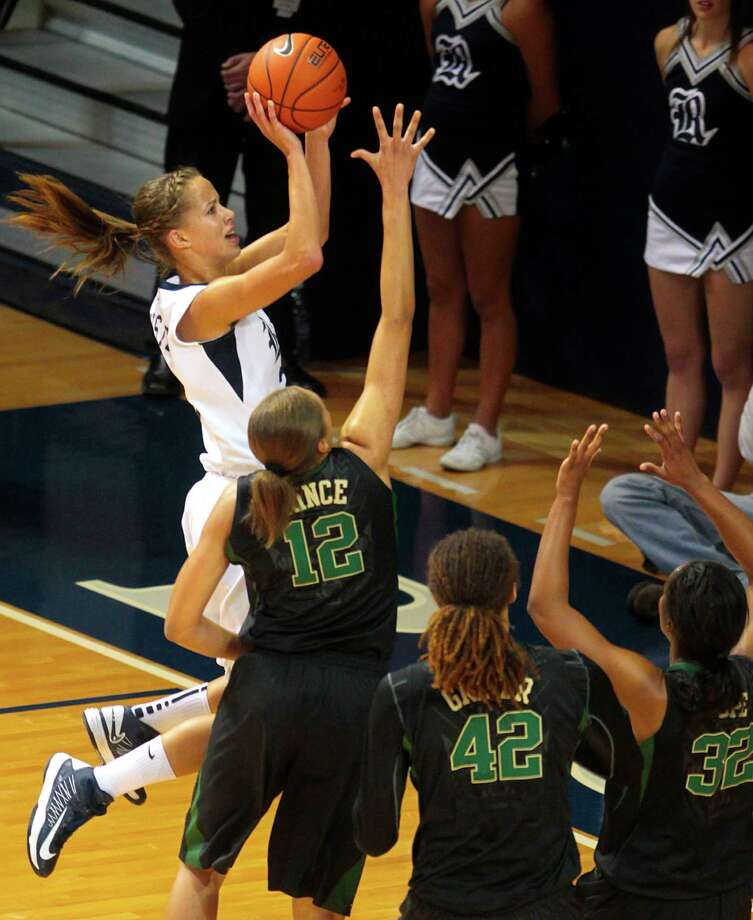 Rice's forward Jessica Kuster shoots over a host of Baylor defenders during the first half of the Rice Owls match-up with the Baylor Bears at Tudor Field House Tuesday, Nov. 27, 2012, in Houston. Photo: Billy Smith II, Houston Chronicle / © 2012 Houston Chronicle