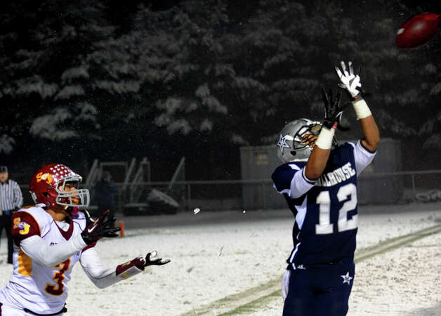 Hillhouse's #12 Daryn Horner goes to intercept a pass intended for St. Joseph's #3 Jake Pelletier, during Class M state football quarterfinal action in East Haven, Conn. on Tuesday November 27, 2012. Photo: Christian Abraham / Connecticut Post