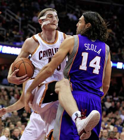 Cleveland Cavaliers' Tyler Zeller, left, gets a rebound ahead of Phoenix Suns' Luis Scola during the second quarter of an NBA basketball game Tuesday, Nov. 27, 2012, in Cleveland. (AP Photo/Tony Dejak) Photo: Tony Dejak