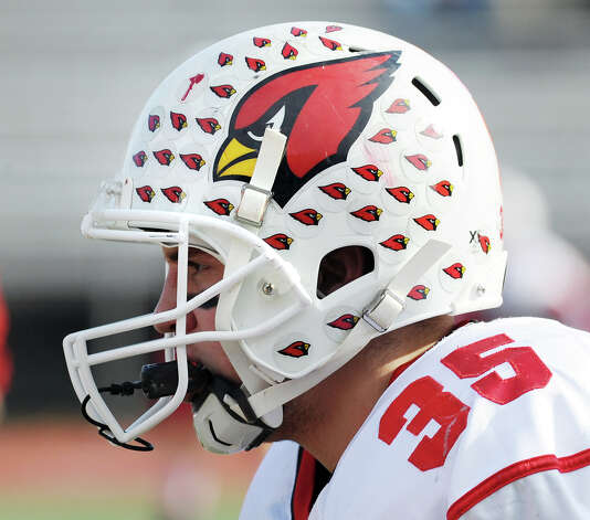 Greenwich High's Mark Bernstein displays his helmet stickers during a win over McMahon earlier this season. Greenwich will travel to Middletown on Wednesday to face Xavier in the Class LL quarterfinals. The game, originally scheduled for Tuesday, was postponed due to weather. Photo: Bob Luckey / Greenwich Time