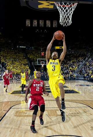 Michigan's Trey Burke, who had 18 points and a career-high 11 assists, leaves N.C. State's Lorenzo Brown in the dust. Photo: Tony Ding, Associated Press