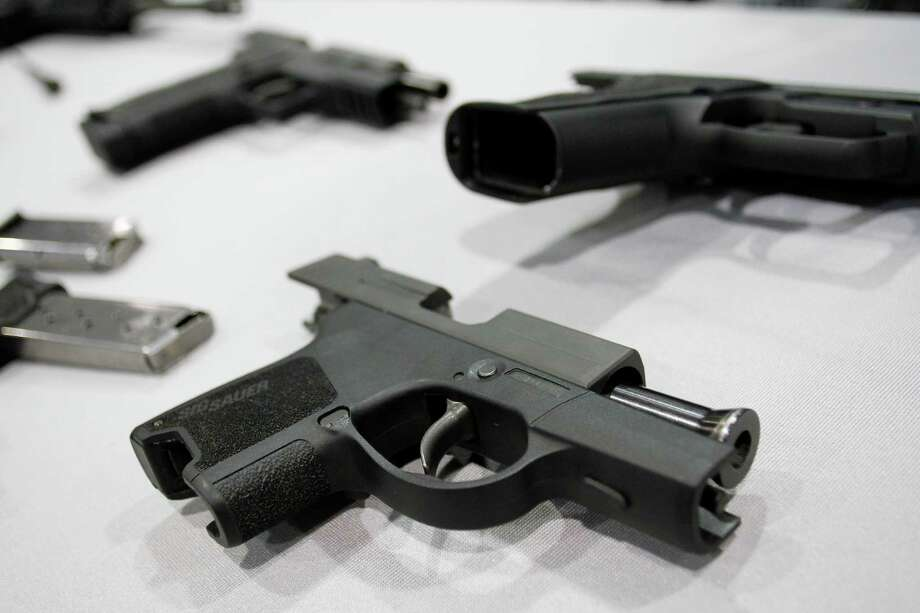A Sig Sauer P290 micro 9mm pistol on display at at the Border Security Expo  in Phoenix, March 6, 2012.  (Joshua Lott/The New York Times) Photo: JOSHUA LOTT / NYTNS