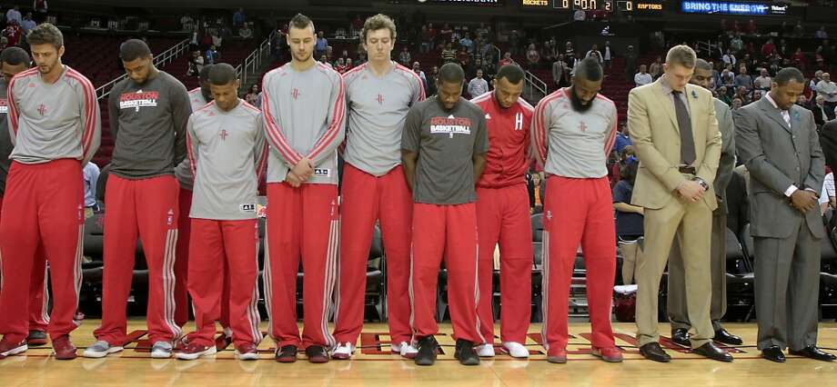 Rockets players bow in reflection for the death of Kevin McHale's daughter. (James Nielsen / Houston Chronicle)