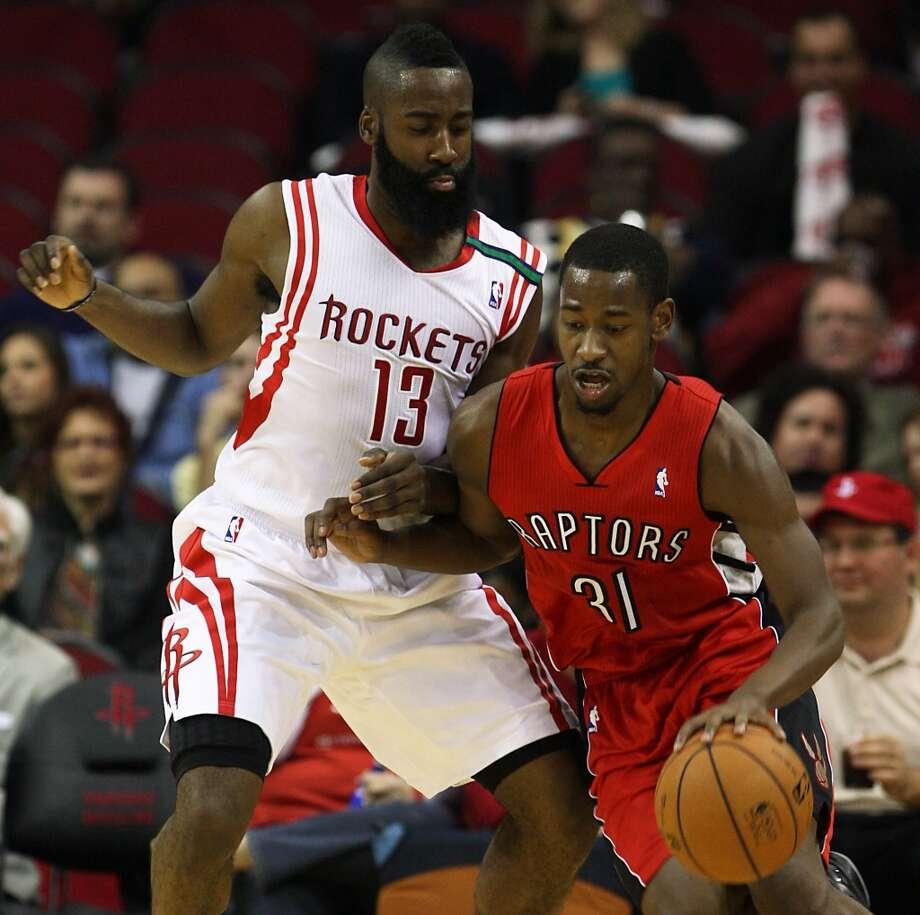 Rockets guard James Harden defends Raptors guard Terrence Ross.  (James Nielsen / Houston Chronicle)
