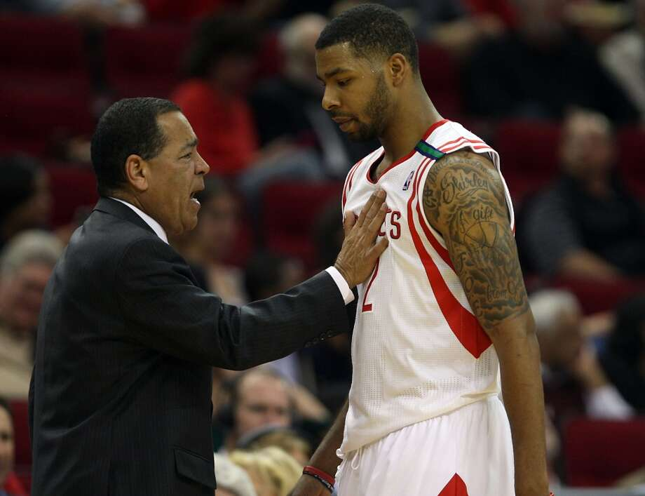 Rockets acting coach Kelvin Sampson speaks to forward Marcus Morris on the sidelines. (James Nielsen / Houston Chronicle)