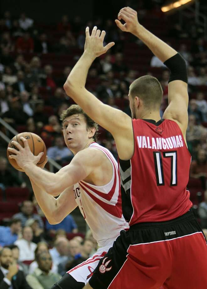Rockets center Omer Asik looks for an opening in the Raptors' defense. (James Nielsen / Houston Chronicle)