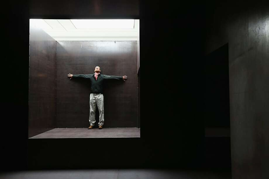 """Cubist art:Artist Anthony Gormley stands inside his installation """"Model"""" at the White Cube Gallery in London. Photo: Dan Kitwood, Getty Images"""