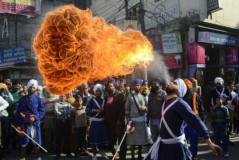 Accelerent accrued is easily spewed: An Indian Sikh Nihang (warrior) dazzles the crowd with a highly flammable burp during a procession from Sri Akal Takhat to the Golden Temple in Amritsar, India. Photo: Narinder Nanu, AFP/Getty Images