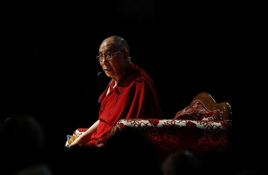 Tibetan spiritual leader the Dalai Lama addresses Tibetan exiles living in Bangalore, in Bangalore, India, Tuesday, Nov. 27, 2012. The 77-year-old Nobel Peace Prize winner travels across the world to give talks. Photo: Aijaz Rahi, Associated Press