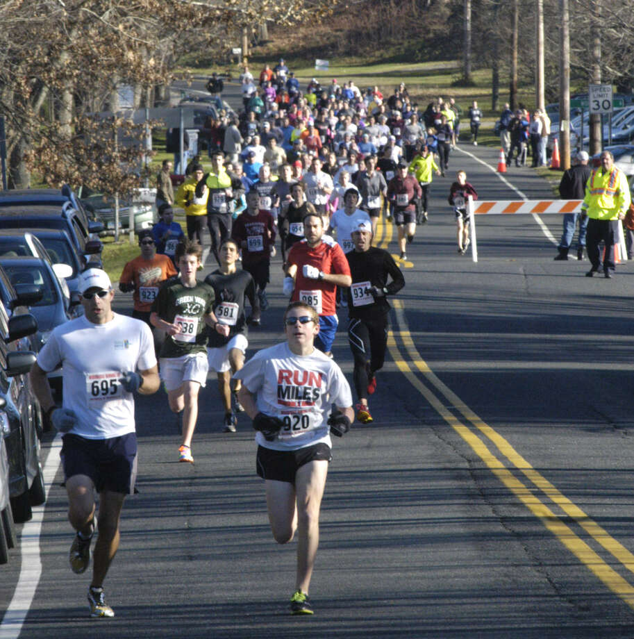 Jeff Sheldon, left, of Southbury and Stosh Davis of New Milford assume the early lead in the 12th annual Run for A Cure, a Thanksgiving Day event hosted by the Roxbury road race series and the Roxbury Congregational Church as a benefit for the Regional Cancer Center at New Milford Hospital and the American Cancer Society's Relay for Life. Nov. 22, 2012 Photo: Norm Cummings