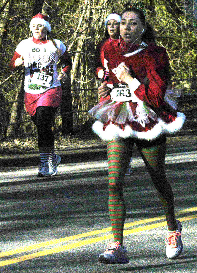 "Kelly Wohlfarth, 29, of Danbury sports a stylish and seasonally colorful ensemble as she jogs the final half-mile of ""Run, Santa, Run 2 - The Sequel,"" a five-kilometer road race hosted Nov. 24, 2012 in New Milford by the St. Peter's Lodge No. 21 Masons as a benefit for American Diabetes Association. Photo: Norm Cummings"