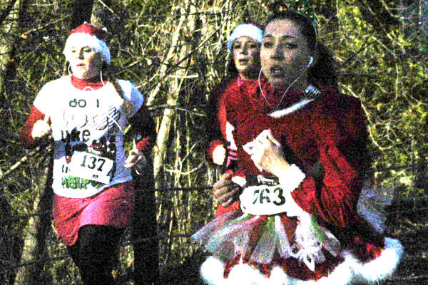"Kelly Wohlfarth, 29, of Danbury sports a stylish and seasonally colorful ensemble as she jogs the final half-mile of ""Run, Santa, Run 2 - The Sequel,"" a five-kilometer road race hosted Nov. 24, 2012 in New Milford by the St. Peter's Lodge No. 21 Masons as a benefit for American Diabetes Association."