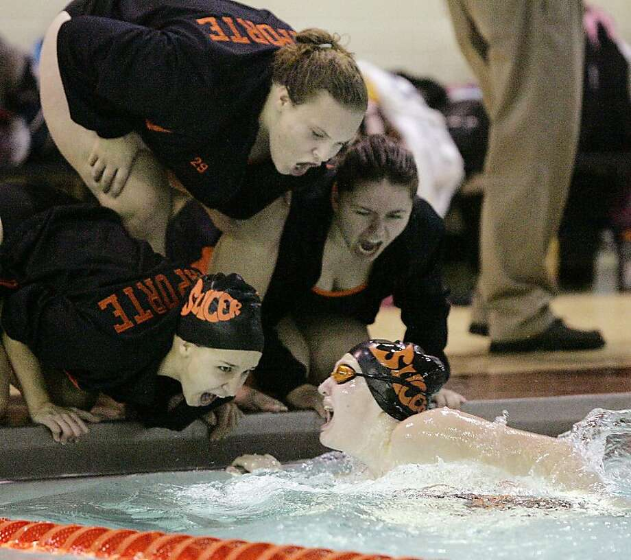 LaPorte's Elizabeth Dusza is cheered on by teammates as she makes a turn during the 200-meter individual relay during a high school swim meet against Michigan City, Tuesday, Nov. 27, 2012, in LaPorte, Ind. Photo: Bob Wellinski, Associated Press