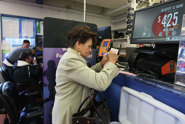 Agripina Hauschild, 77, buys Powerball tickets at the Texas Food Mart on Cupples Road, Tuesday, Nov. 27, 2012. The drawing is Wednesday night and by early Tuesday afternoon, the estimated annuitized jackpot was at $500 million. Photo: Jerry Lara, San Antonio Express-News / © 2012 San Antonio Express-News
