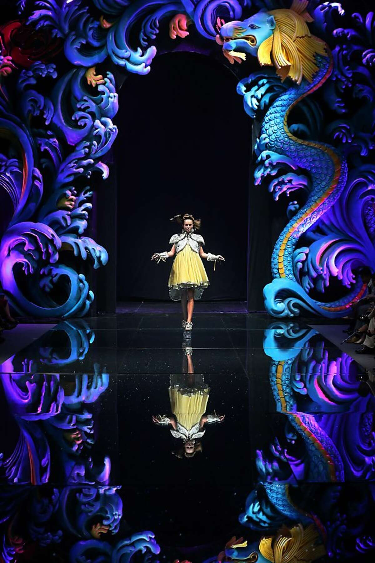 A model showcases a creation by Chinese designer Guo Pei on Tuesday Nov. 27, 2012, in Singapore during the Asian Couture 2012 Singapore fashion show. (AP Photo/Wong Maye-E)